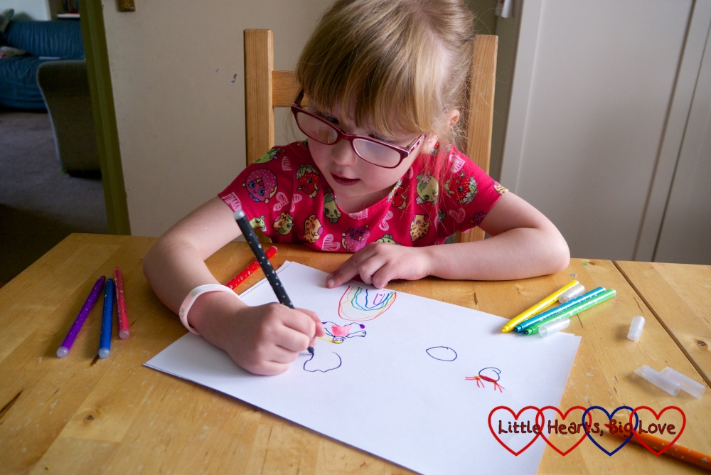 Jessica drawing a picture