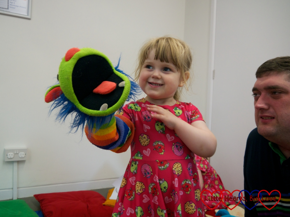 Sophie playing with a monster hand puppet