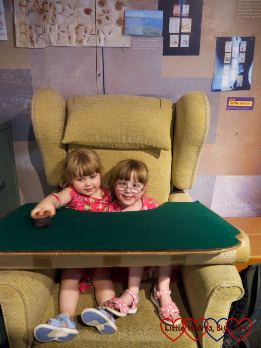 Jessica and Sophie sitting in a replica of Roald Dahl's writing chair