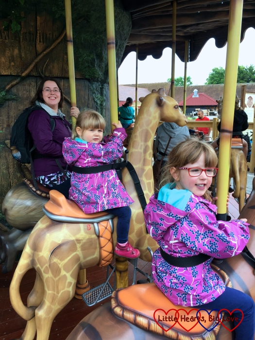 Me, Sophie and Jessica riding on jungle animals on the Adventure Tree carousel