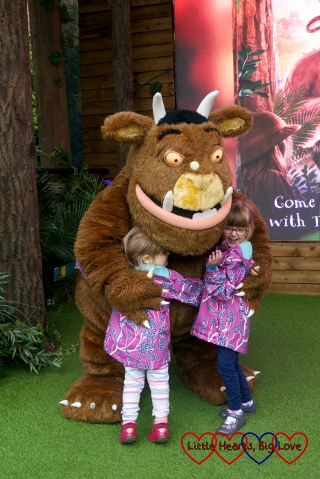 Jessica and Sophie giving the Gruffalo a hug