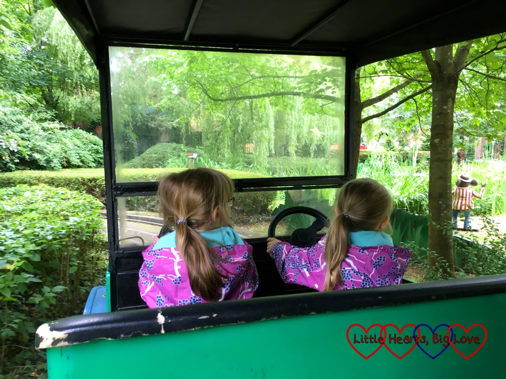 Jessica and Sophie driving one of Toadie's Crazy Cars at Chessington World of Adventures