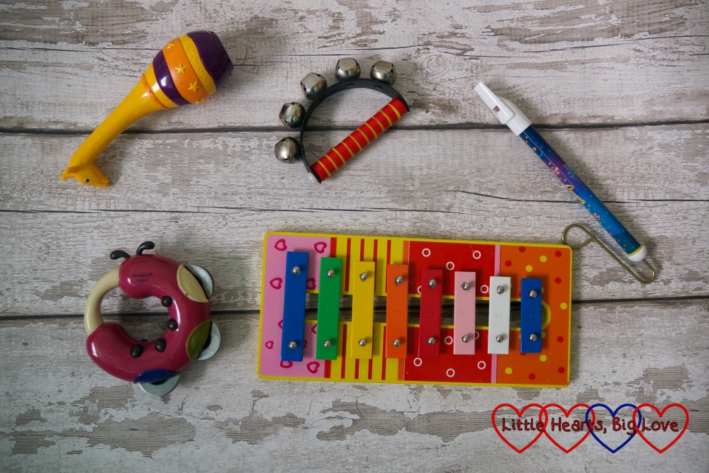 A selection of children's musical insturments - maracas, bells, slide whistle and a xylophone