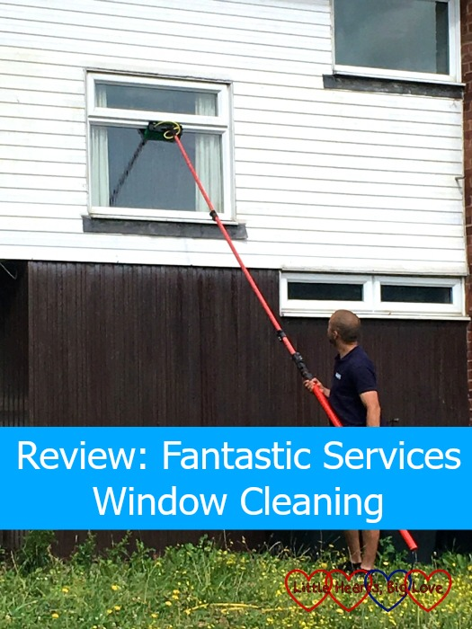 "The window cleaner from Fantastic Services cleaning the outside of my windows - ""Review: Fantastic Services Window Cleaning"""