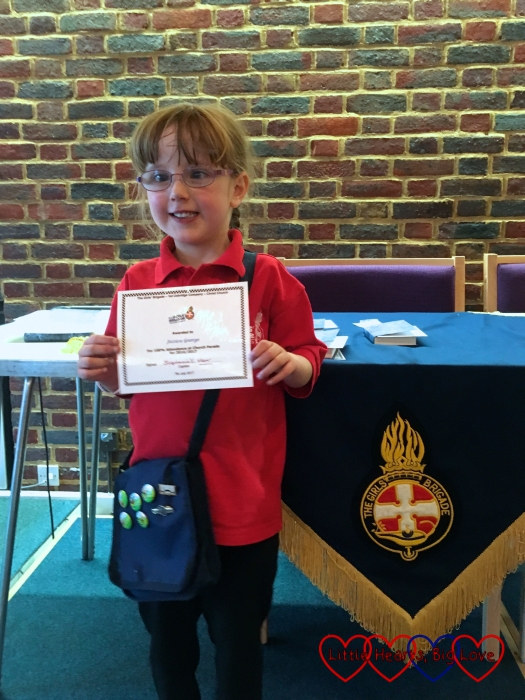 Jessica with her certificate for 100% attendance at church parade at the Girls' Brigade awards evening