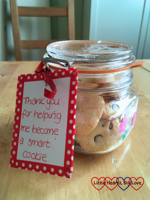 """Chocolate chip and orange biscuits in a jar with a label saying """"thank you for helping me become a smart cookie"""""""