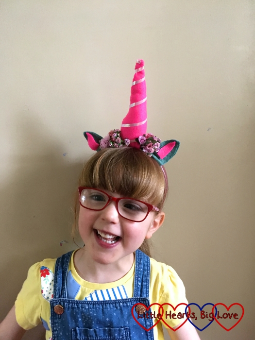 Jessica wearing the unicorn horn headband I made for her