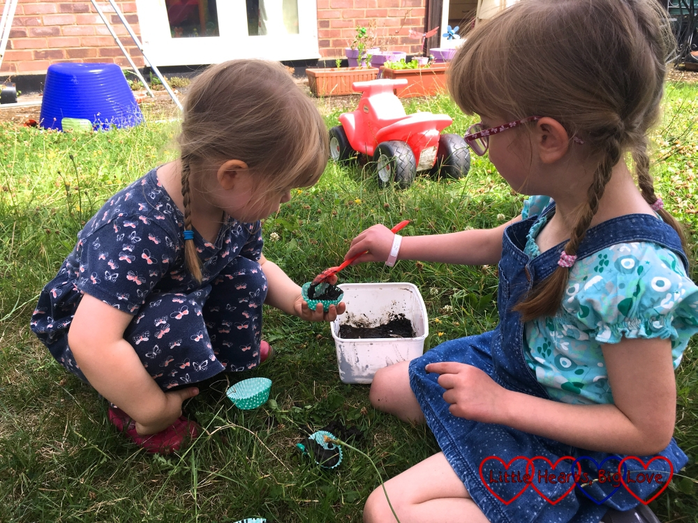 Jessica and Sophie making mud cakes together