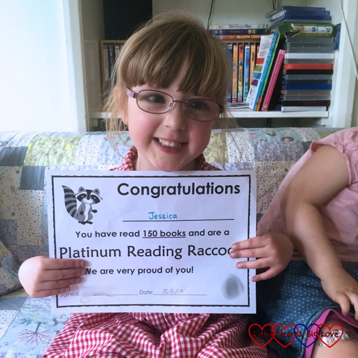Jessica with her platinum reading racoon certificate for having read 150 books