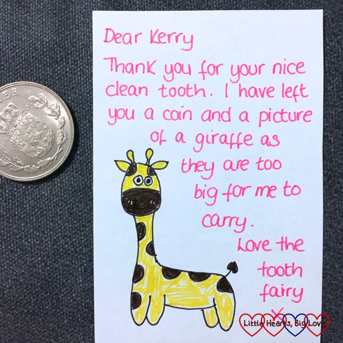 "A coin and a note from the tooth fairy with a picture of a giraffe. The note reads ""Dear Kerry, Thank you for your nice clean tooth. I have left you a coin and a picture of a giraffe as they are too big for me to carry. Love the tooth fairy x"""