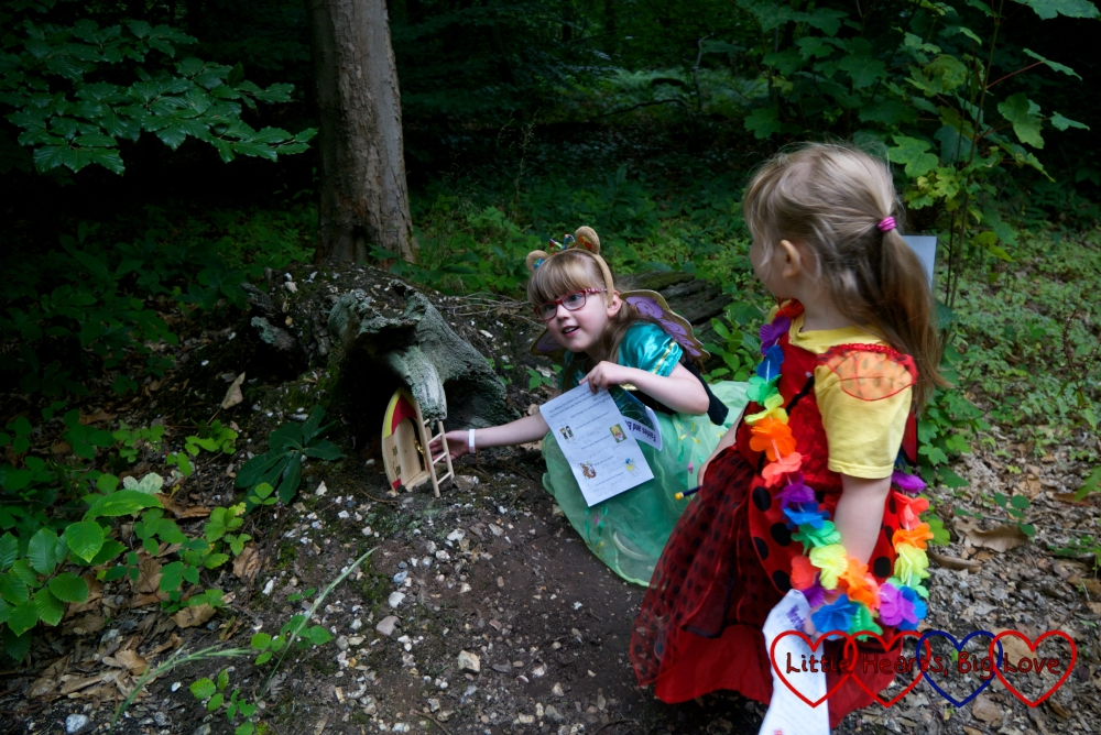 Jessica and Sophie looking closely at one of the fairy doors on the trail in Black Park