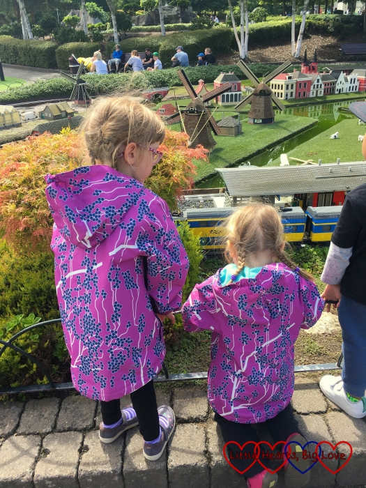 Jessica and Sophie watching one of the trains in Miniland at Legoland