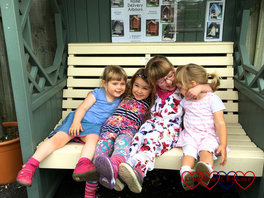 Jessica and Sophie sitting in an arbour with their friends A and S