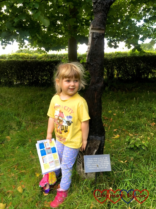 Sophie standing by the charred beam at Jordans Quaker Meeting House with her treasure trail map in her hand