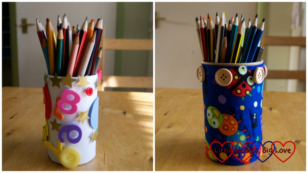 A pencil pot decorated with foam shapes and stars (left) and a pencil pot made with fabric wrapped pot decorated with buttons (right)