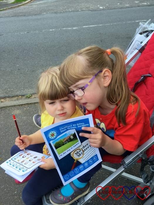 Jessica and Sophie looking at a treasure trail map together