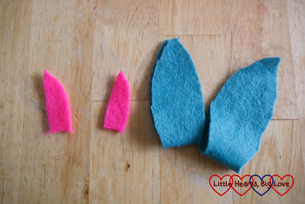 Ear shapes cut out of two contrasting pieces of felt