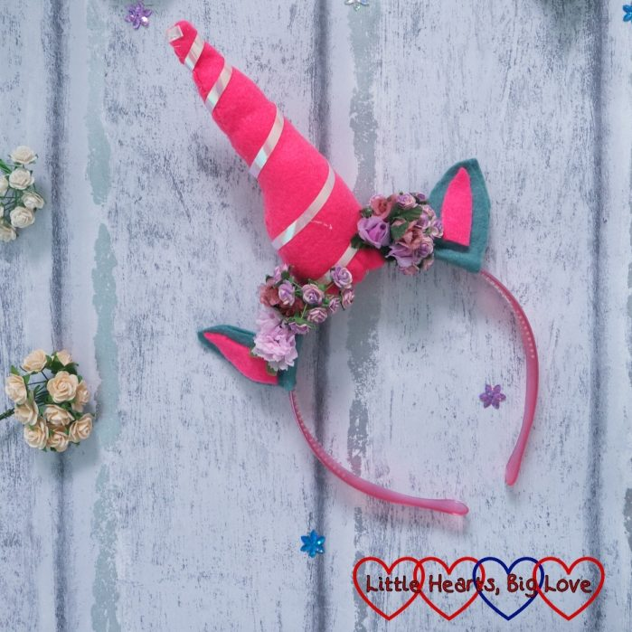 A unicorn horn made from felt, ribbon and artificial flowers
