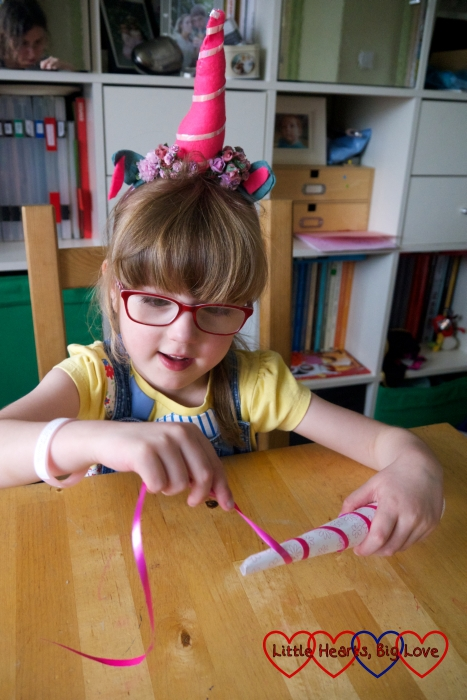 Jessica winding ribbon around the paper cone