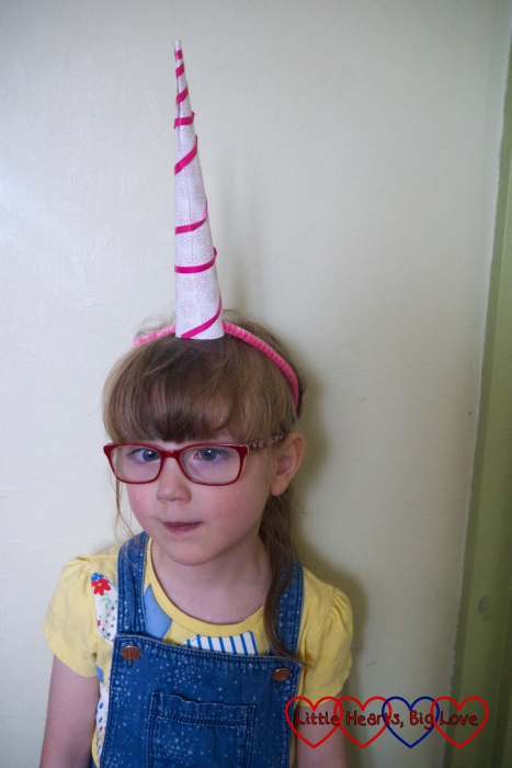 Jessica wearing her paper cone unicorn horn