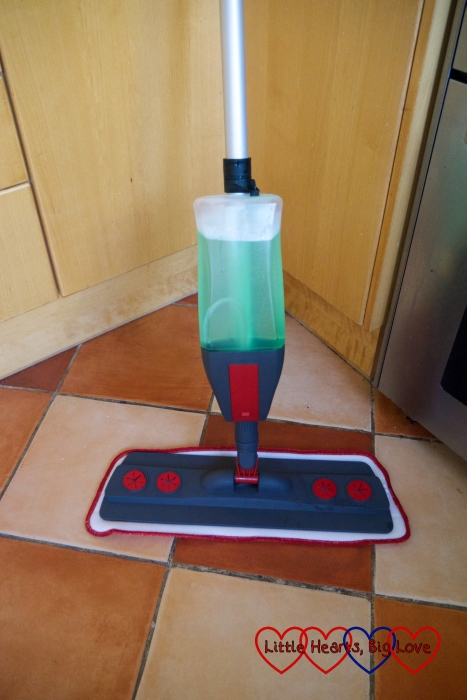 The spray mop with the bottle filled with floor cleaning solution