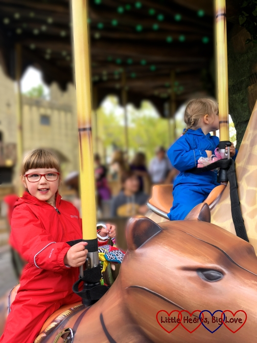 Jessica and Sophie riding the animals on the Adventure Tree carousel at Chessington World of Adventures