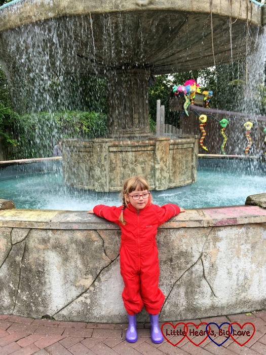 Jessica standing by a fountain at Chessington World of Adventures