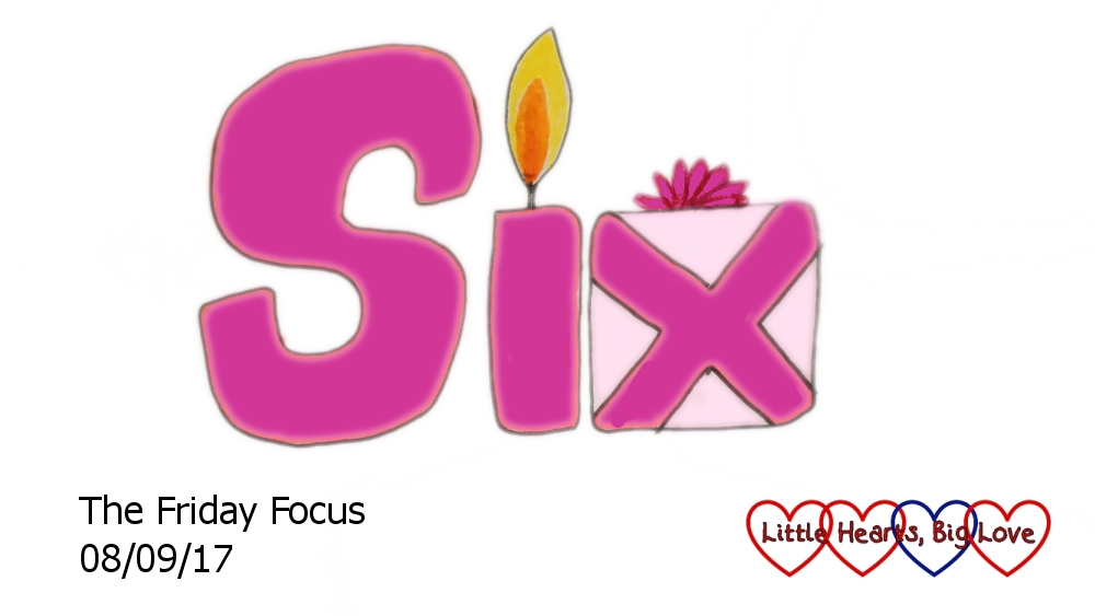 "The word ""six"" drawn with the ""i"" as a candle and the ""x"" as the ribbons on a present"
