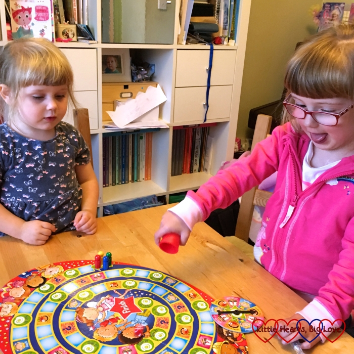 Jessica and Sophie playing a board game