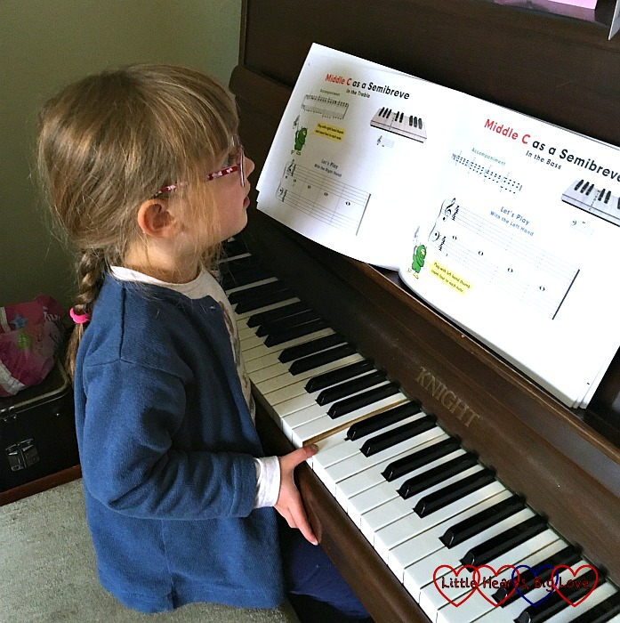 Jessica having her first piano lesson