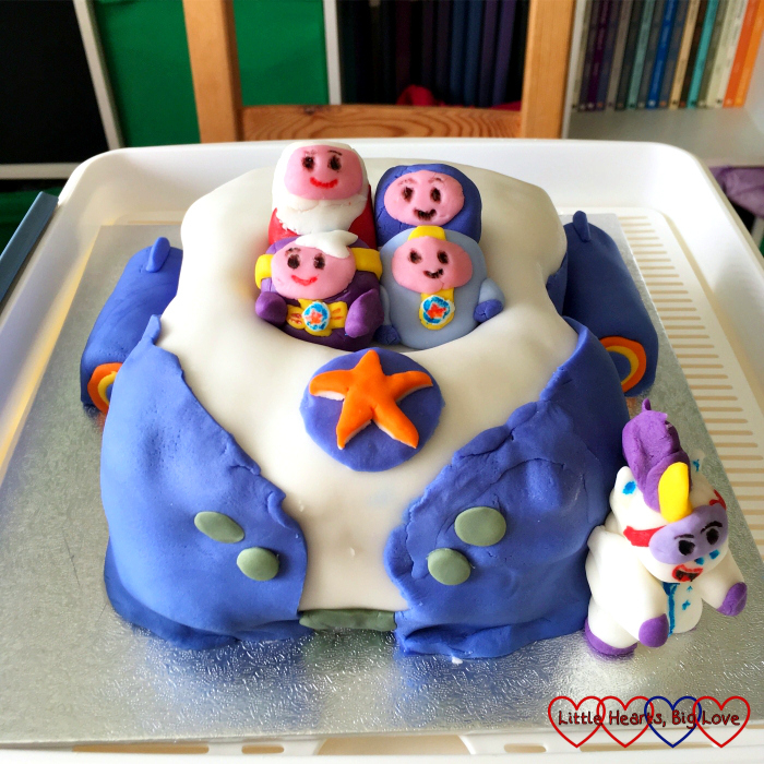 A Go-Jetters Vroomster cake with icing figures of the four Go-Jetters and Ubercorn