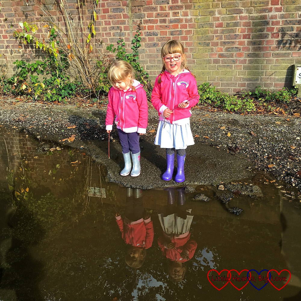 Jessica and Sophie looking into their reflections in a puddle