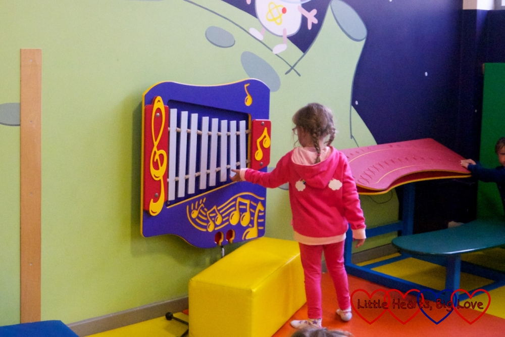 Jessica playing in the music area in George's Spaceship Indoor Playzone