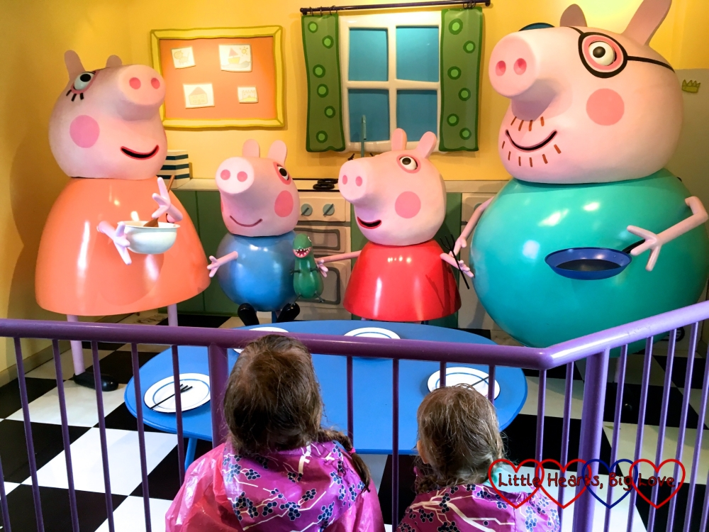 Jessica and Sophie looking at Peppa, George, Mummy and Daddy Pig inside Peppa Pig's House