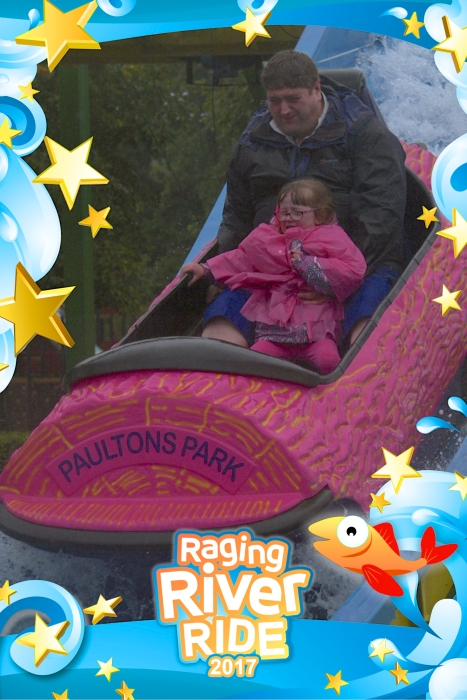 Jessica and hubby on the Raging River log flume ride