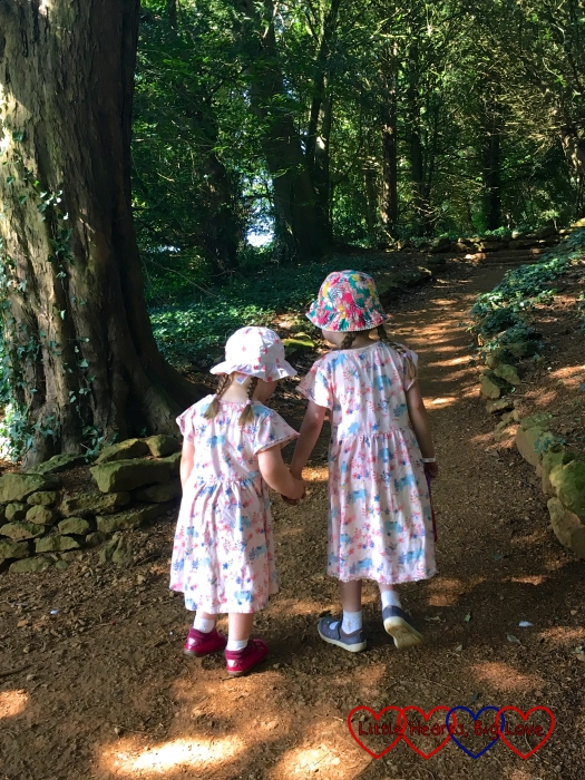 Sophie holding Jessica's hand and helping her to walk uphill