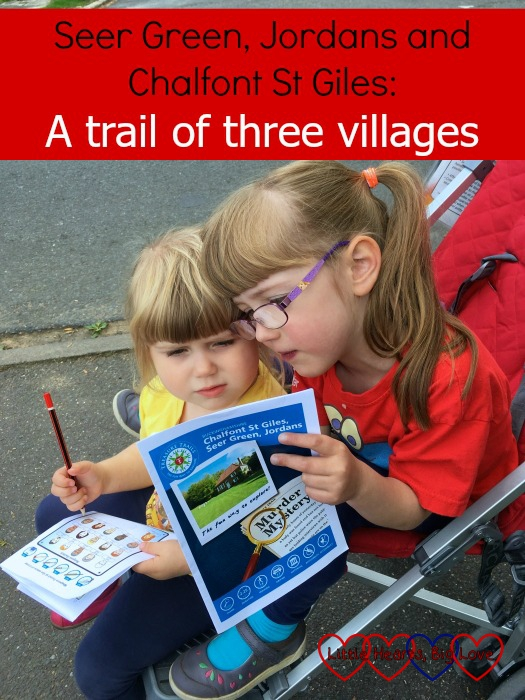 """Jessica and Sophie looking at a treasure trails map together - """"Seer Green, Jordans and Chalfont St Giles - a trail of three villages"""""""