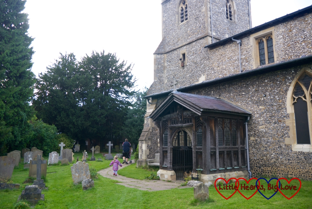 Jessica, Sophie and hubby looking for clues in the churchyard at Chalfont St Giles
