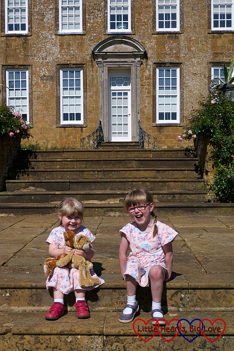 Jessica and Sophie sitting on the steps of the South Terrace at Upton House