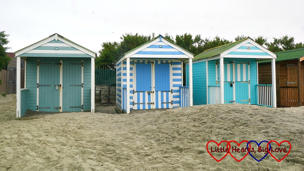 Stripey blue/green and white beach huts at West Wittering beach