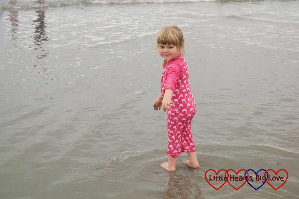 Sophie paddling in the sea at West Wittering