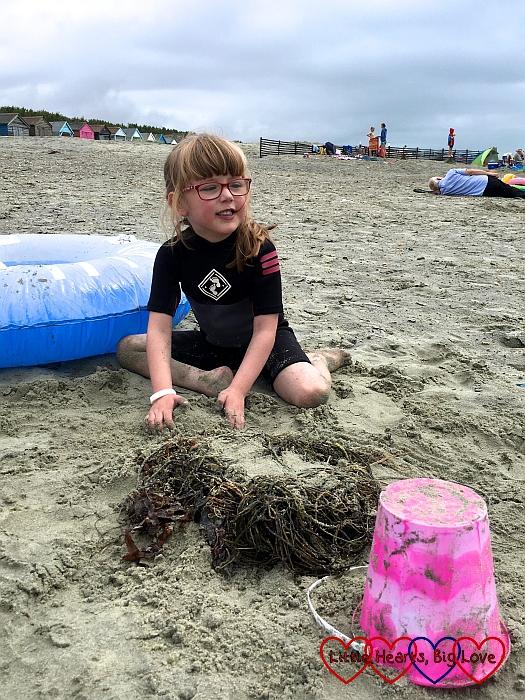 Jessica building a sand castle