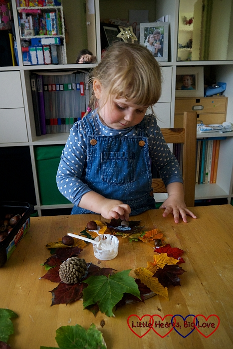 Sophie putting the finishing touches to her autumn wreath