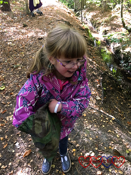 Jessica finding a geocache