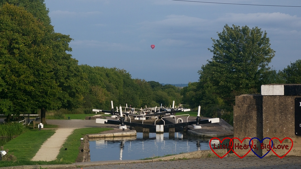 Looking down over the Hatton locks with a hot air balloon in the sky