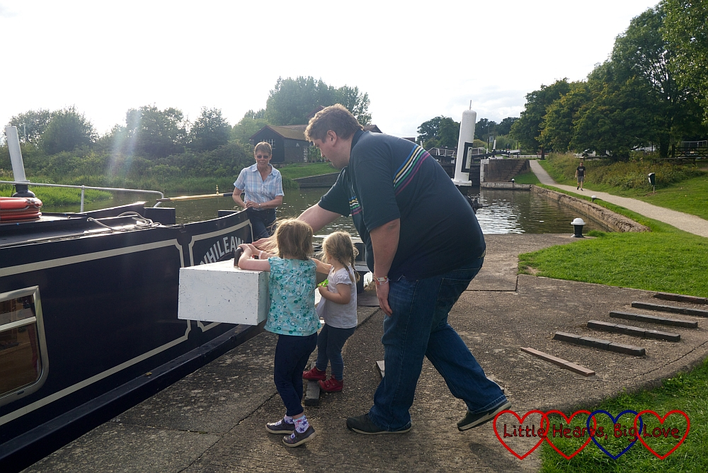 Hubby, Jessica and Sophie getting ready to close the lock gates as the boat enters the lock