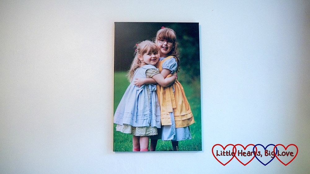 A photo canvas print of my two girls cuddling
