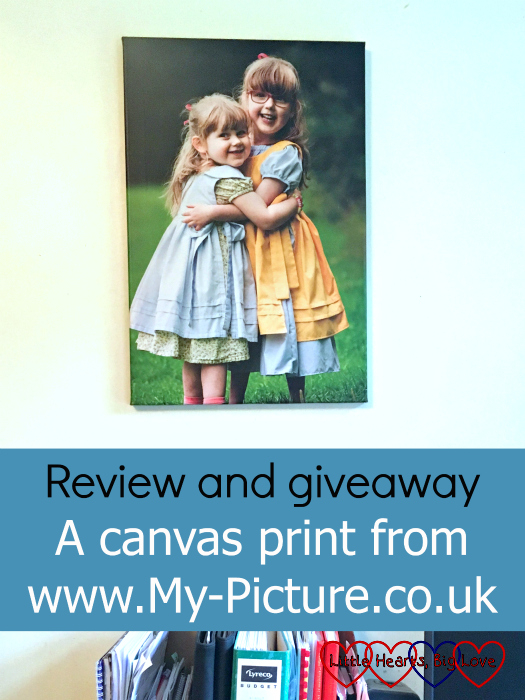 "A photo canvas print of my girls cuddling above my desk - ""Review and giveaway: A canvas print from www.My-Picture.co.uk"""