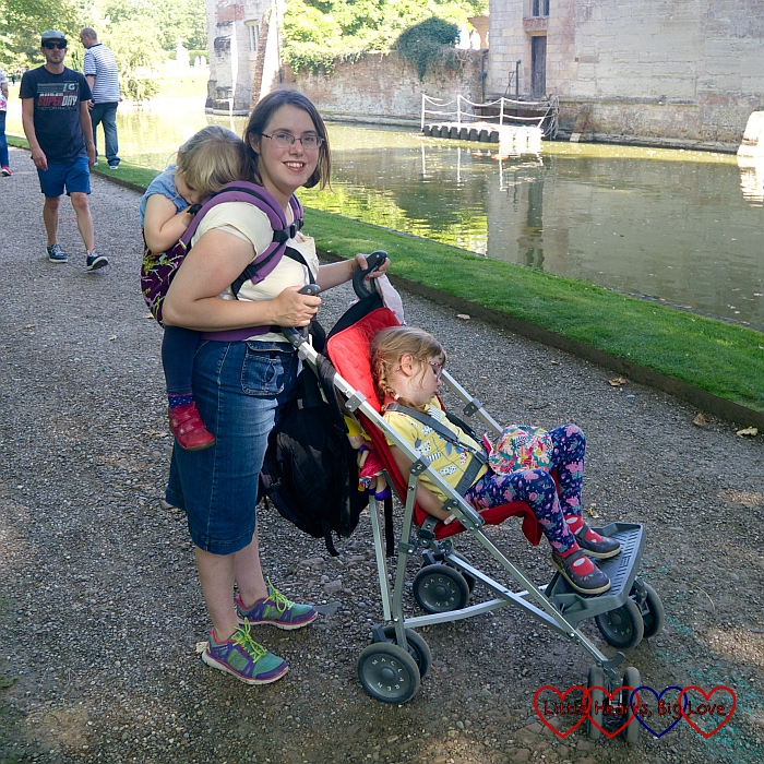 Me with Sophie asleep in the Tula on my back and Jessica asleep in the buggy at Baddesley Clinton