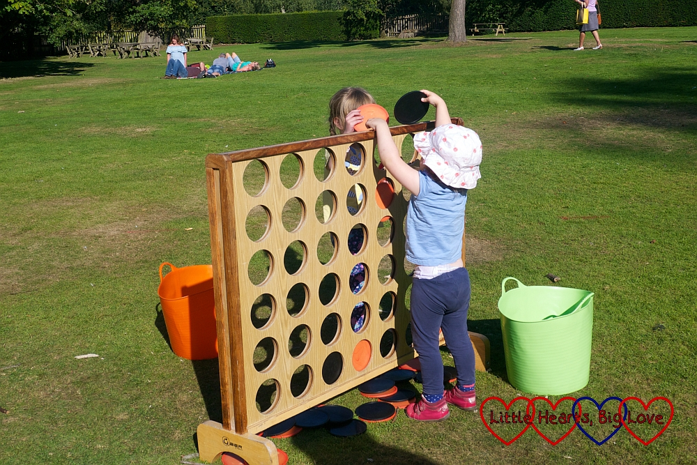 Jessica and Sophie playing giant connect-4 at Baddesley Clinton